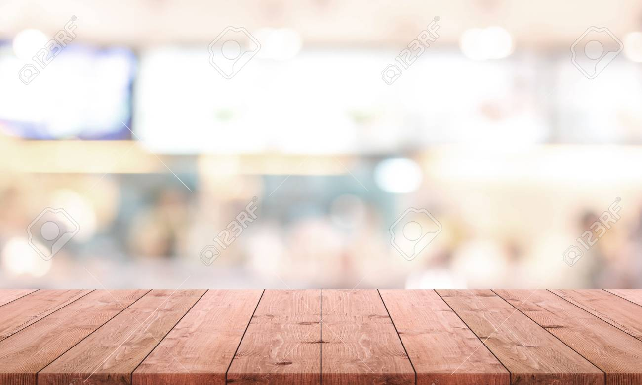 Wood Table Top And Blurred Restaurant Kitchen Interior Background ...