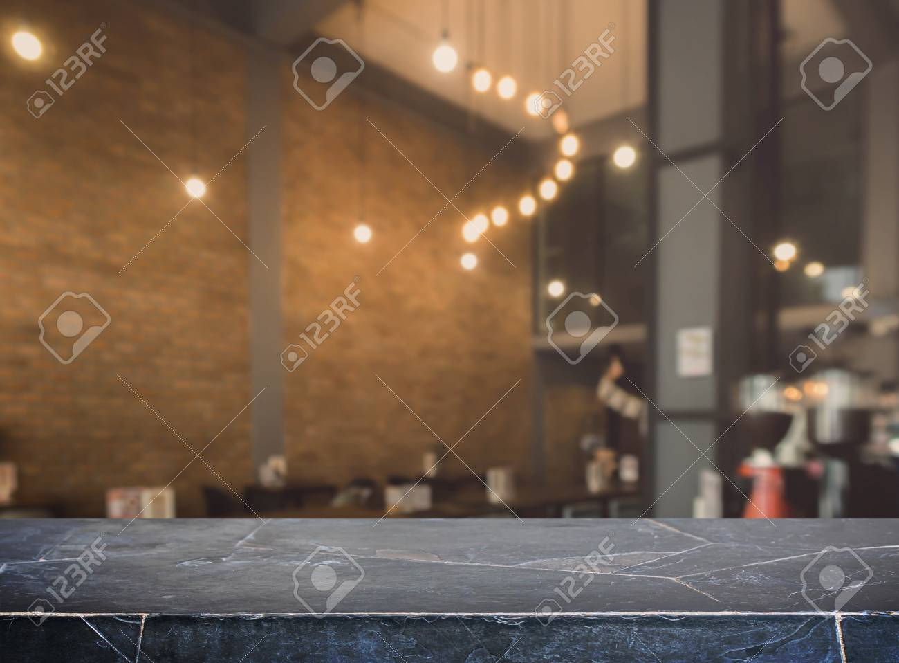 Stock Photo   Stone Marble Table Top And Blurred Bokeh Cafe And Coffee Shop  Interior Background With Vintage Filter   Can Used For Display Or Montage  Your ...