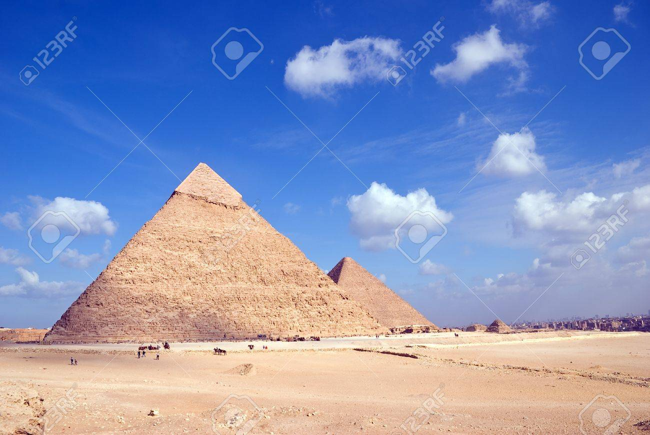 Egypt. Giza. View of the Hefren and Cheops pyramids with Cairo at a distance. - 12375092