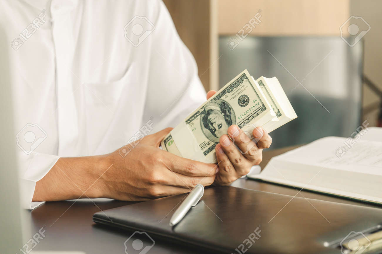 Young business muslim man holding and showing money banknotes, finance concept. - 159181748