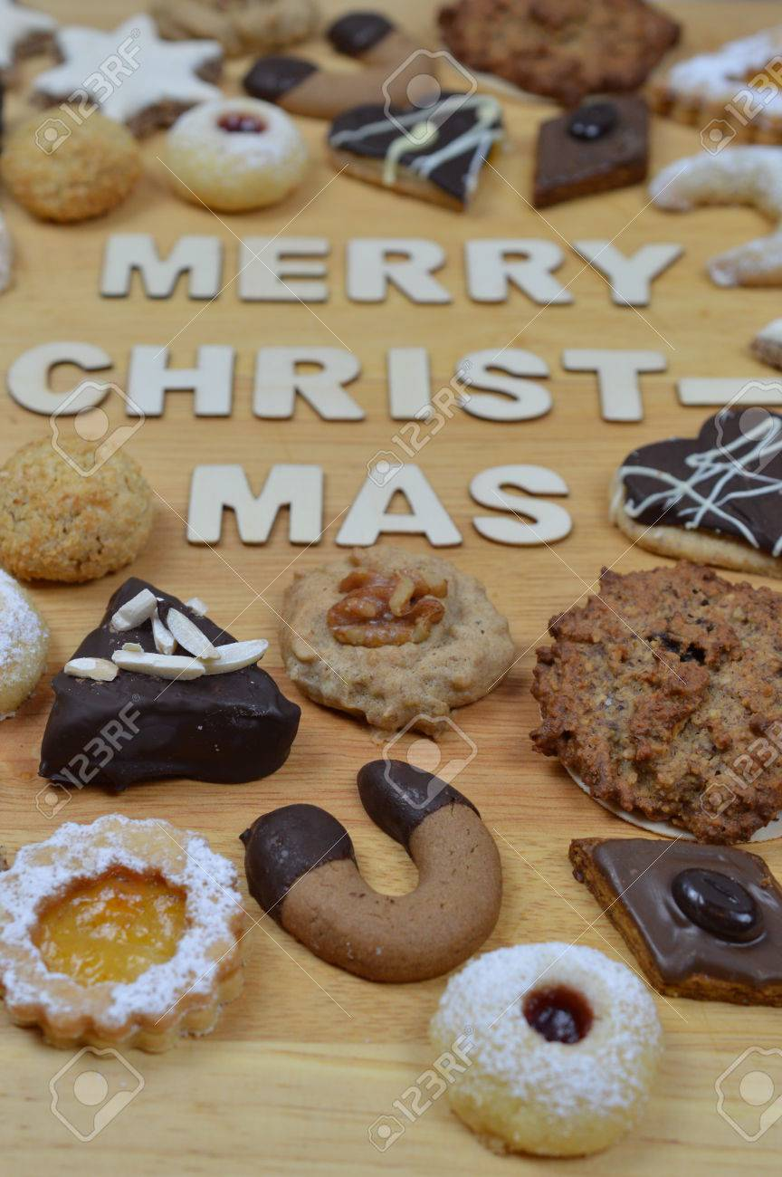 Different Kinds Of Christmas Cookies On A Breadboard Around The