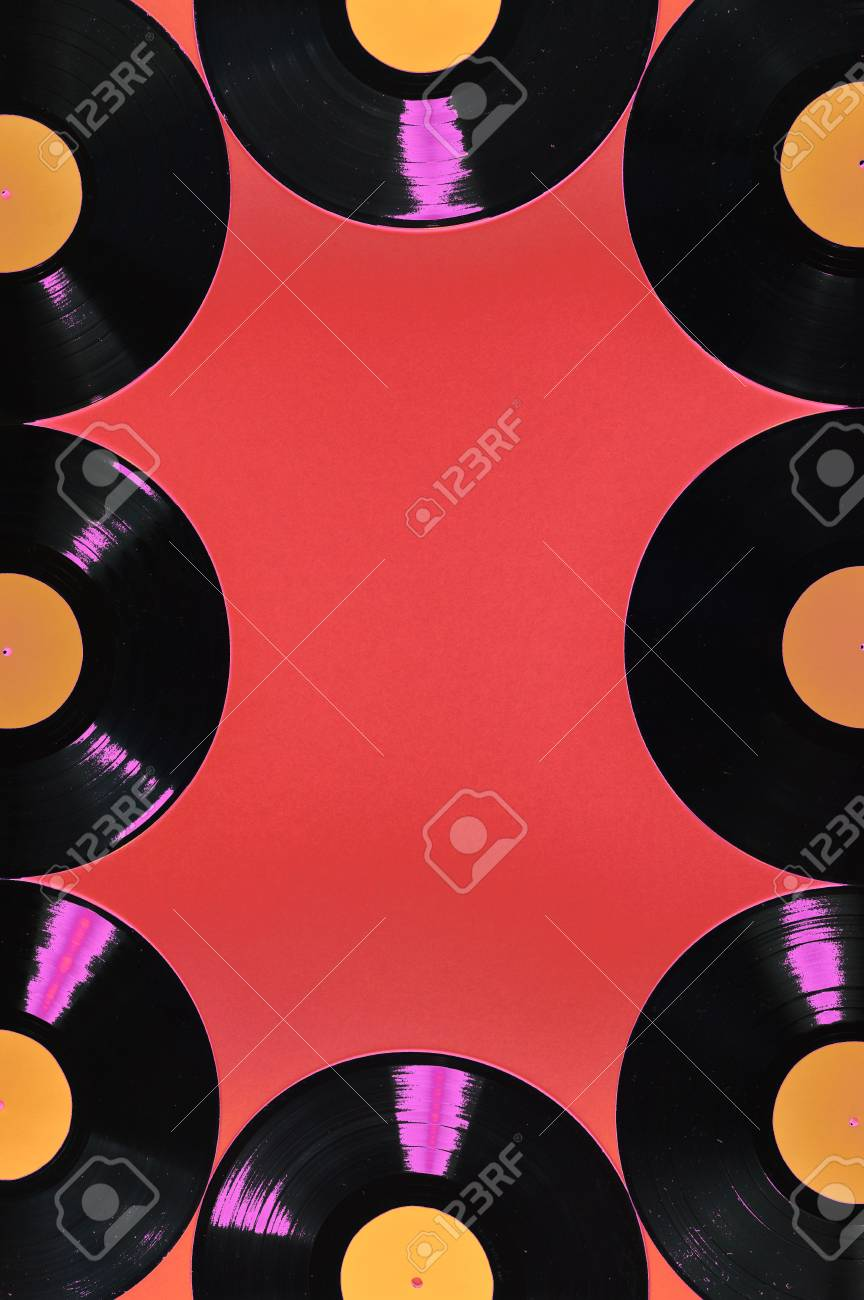 old black vinyl records with blank orange labels on red background