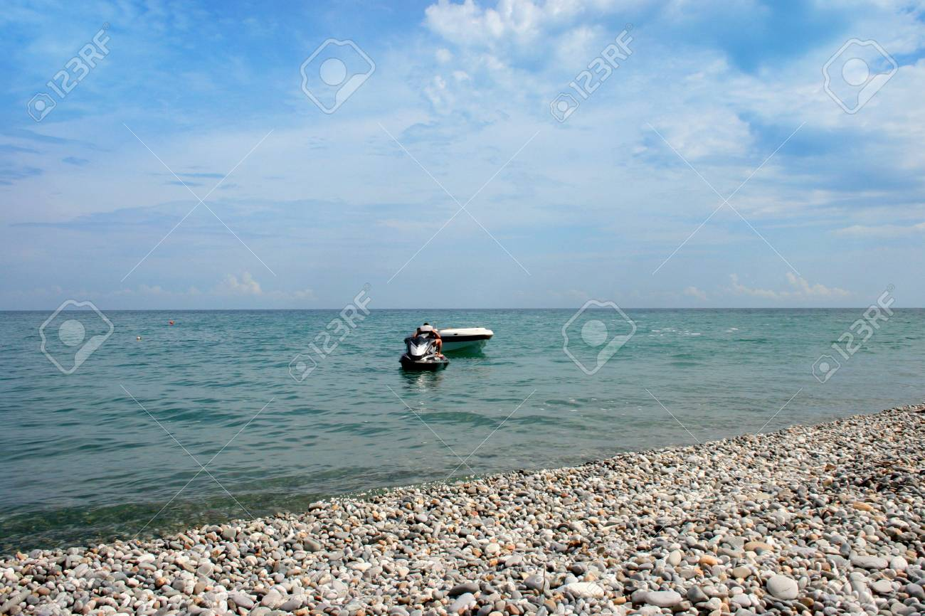 empty seashore and motor boats on background sky Stock Photo - 2981888