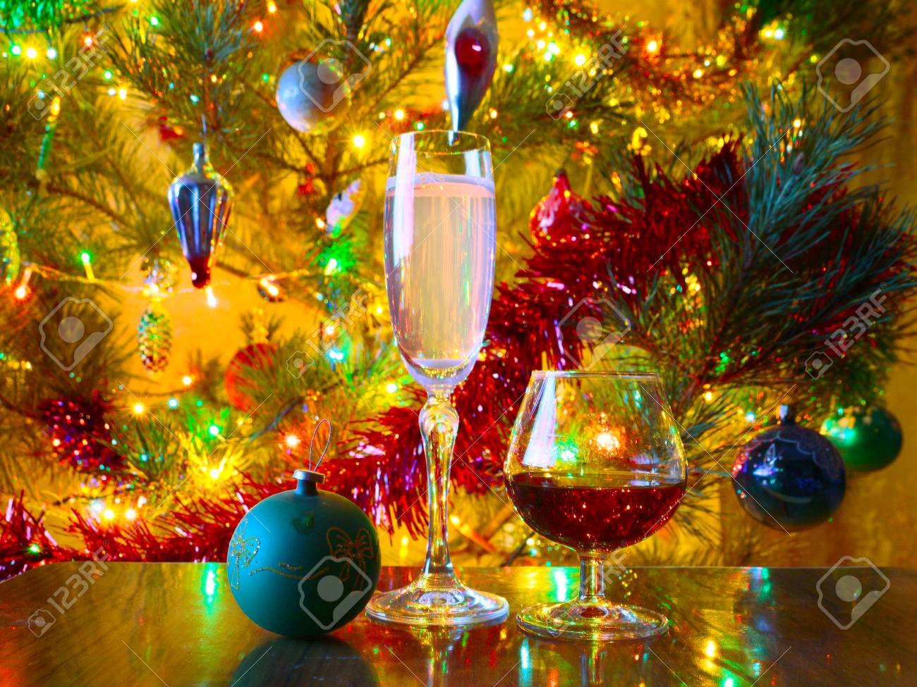 Christmas Liquor.Glasses Of Wine And Strong Liquor On A Background Of Brightly