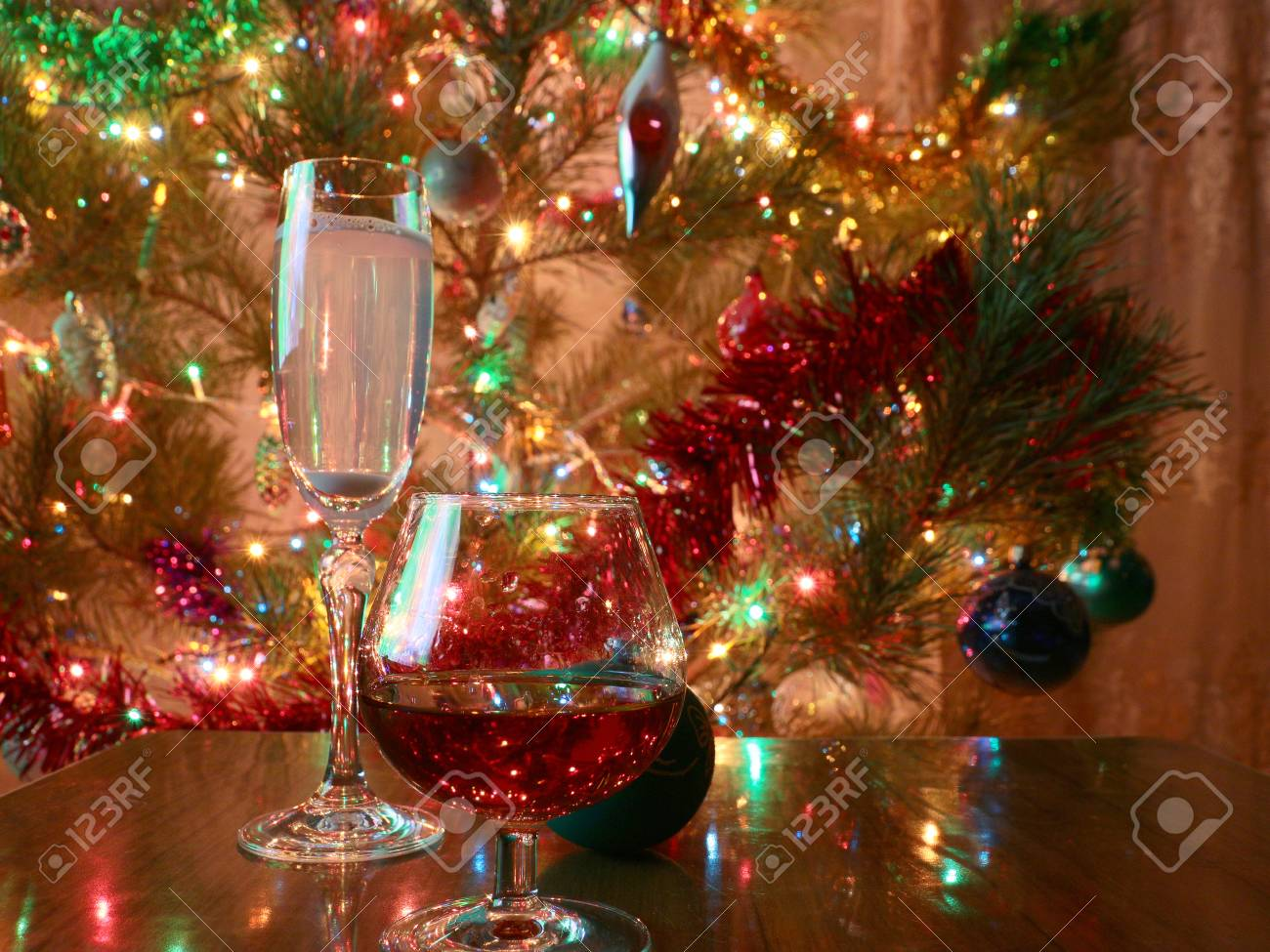 glasses of wine and strong liquor on a background of brightly