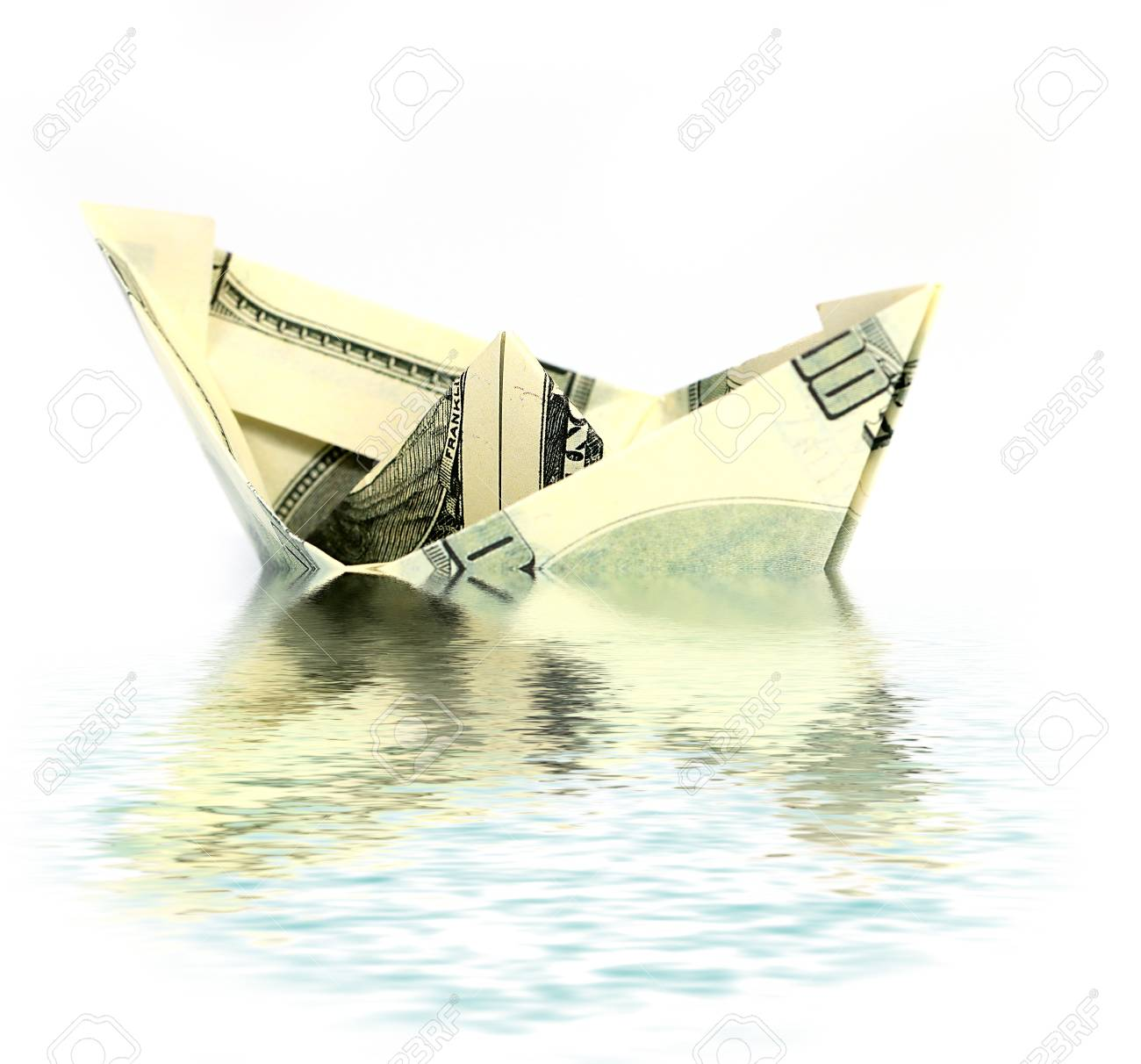 Origami boat made of dollar bill isolated on white background ... | 1212x1300