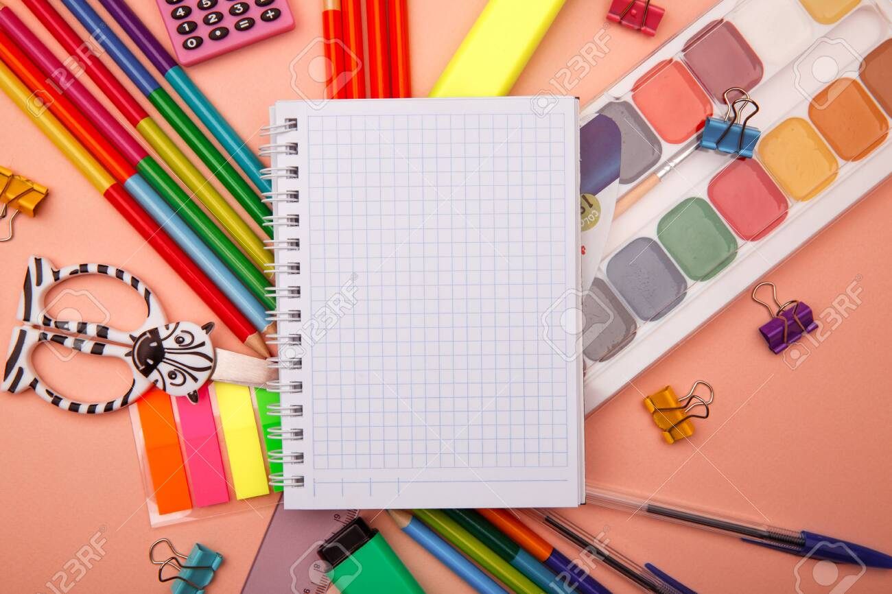 School notebook and various stationery on pink background. Back to school concept. - 153190837