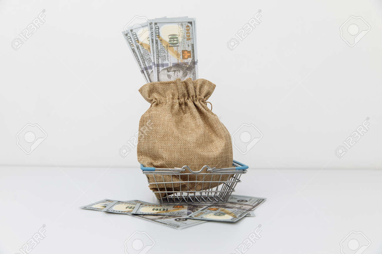 Dollar money bag on a shopping cart. Profits and super profits - 167761330