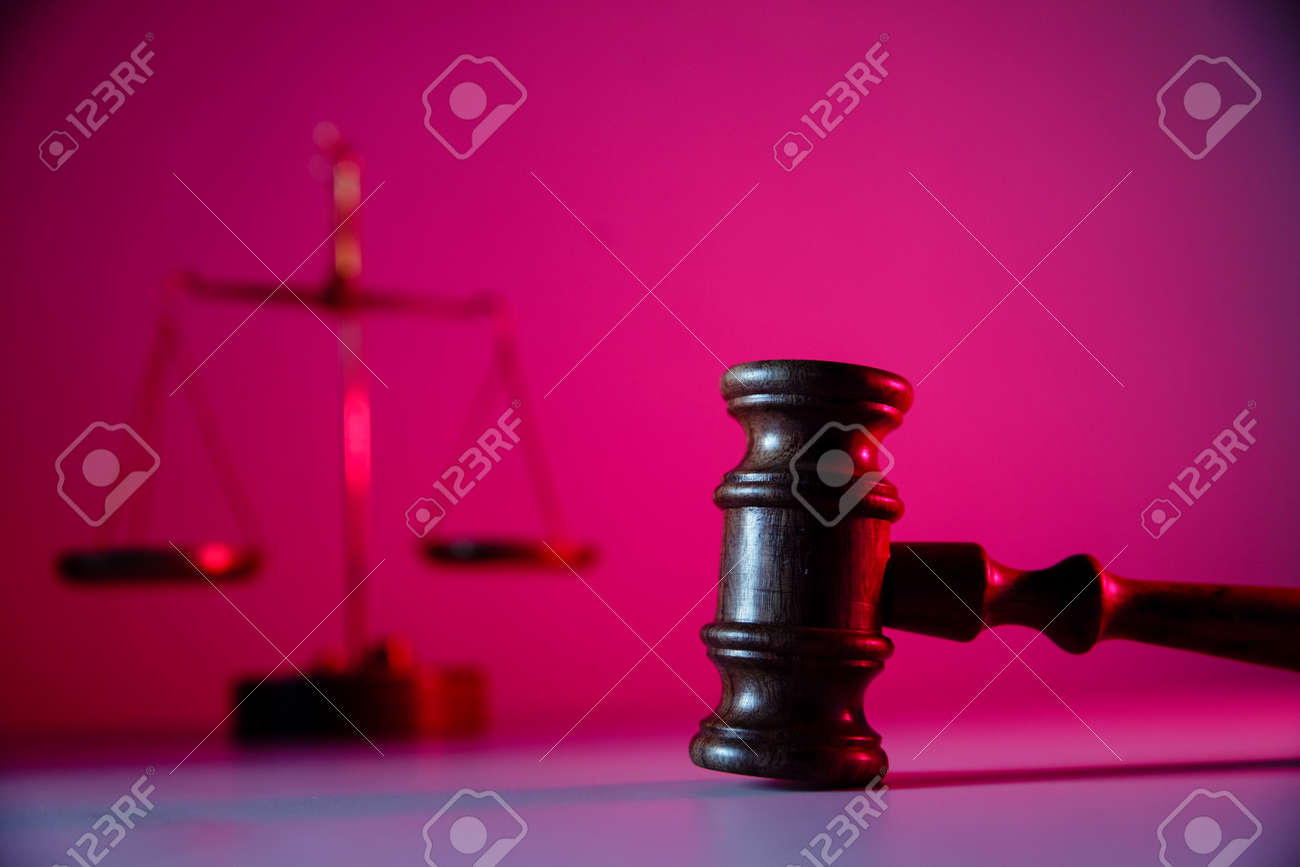 Scales of justice and wooden gavel in courtroom. Law concept - 169819159