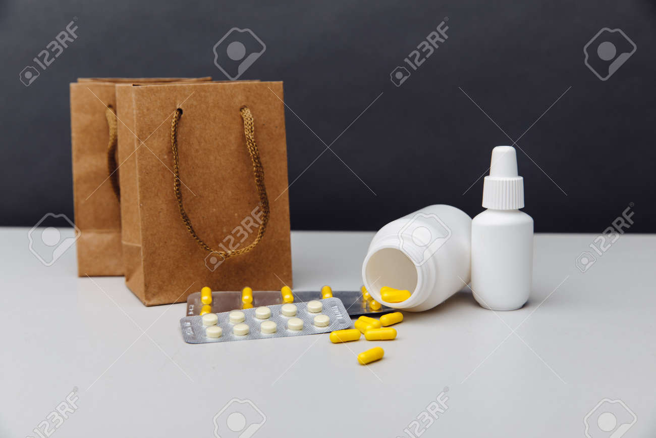 Online shoppng concept. Bags with compounded prescription medications shipped from a mail order pharmacy on a grey background - 169819163