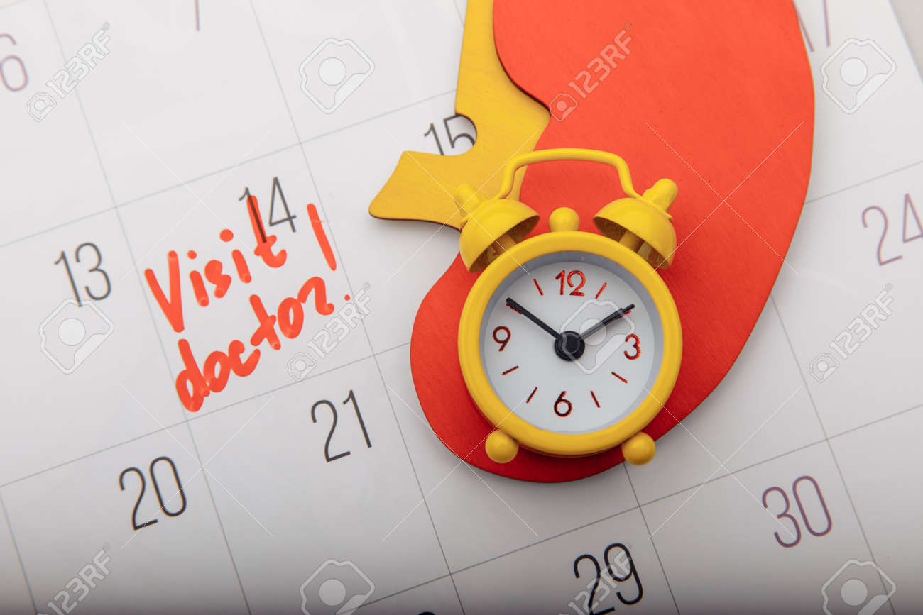 Model of kidney on calendar with mark. Healthcare concept - 169819574
