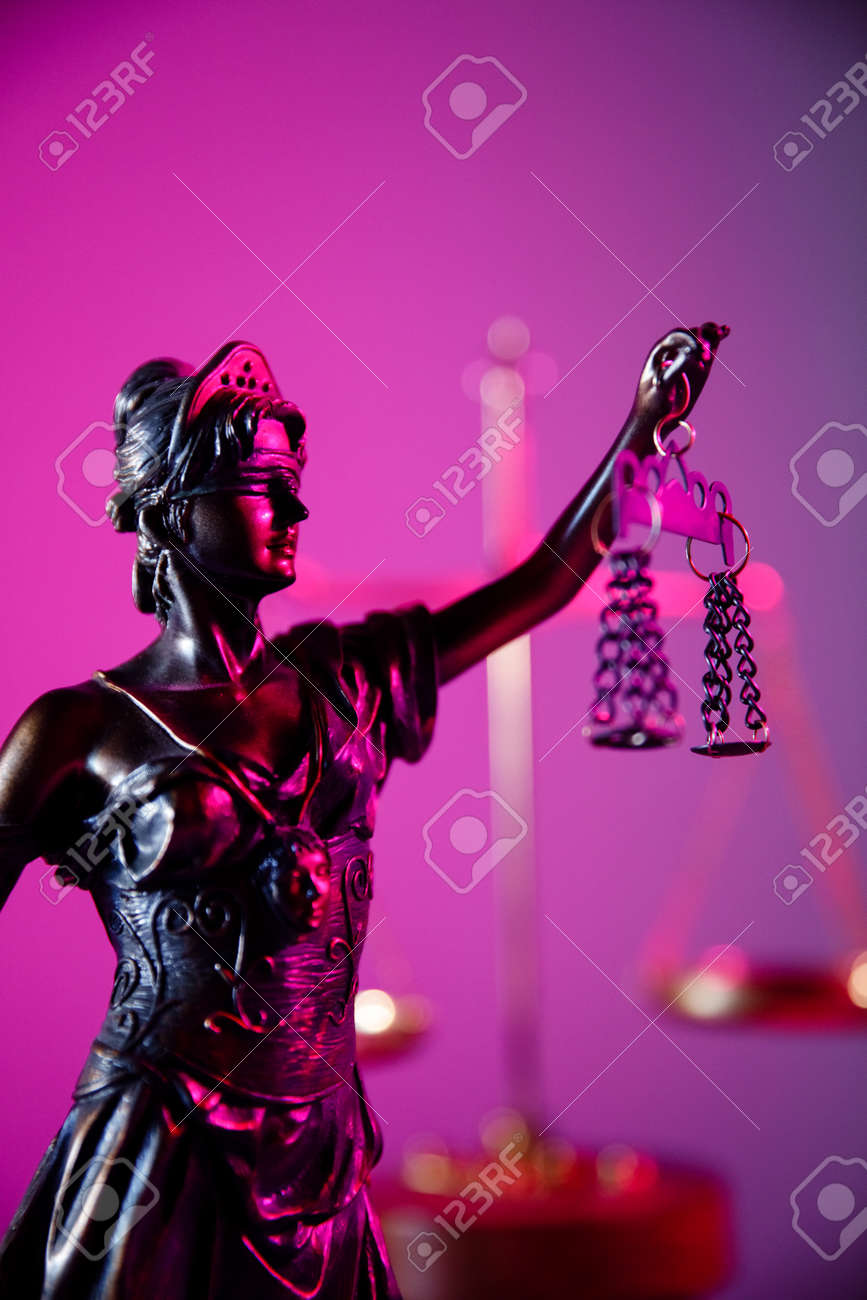 Law and judgment concept. Figure of Lady Justice in purple neon. Vertical image - 169819665