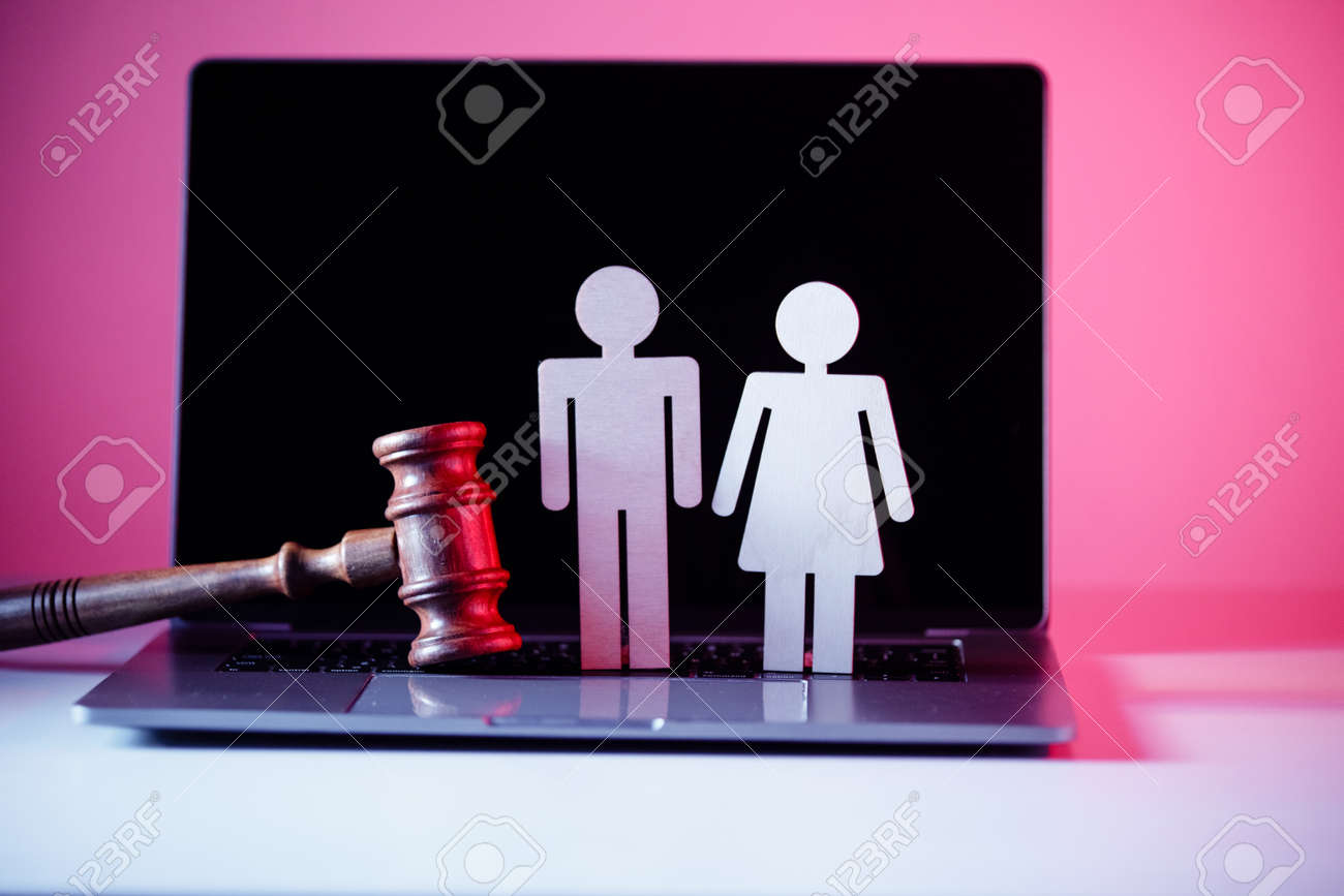 Wooden figure in shape of people and gavel on the table. Family law concept - 169820259