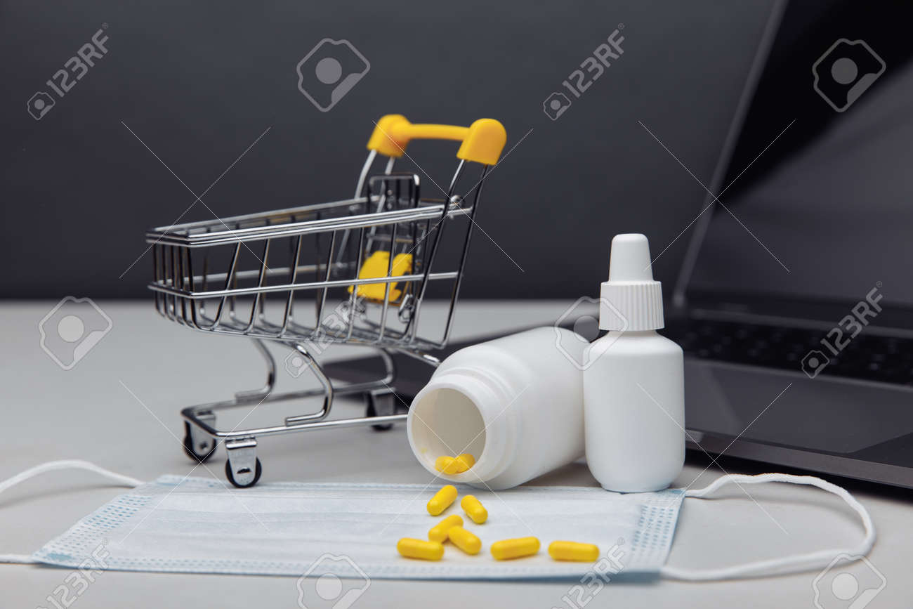 Small shopping cart with medicines. Concept for online purchase of medicines - 169820264