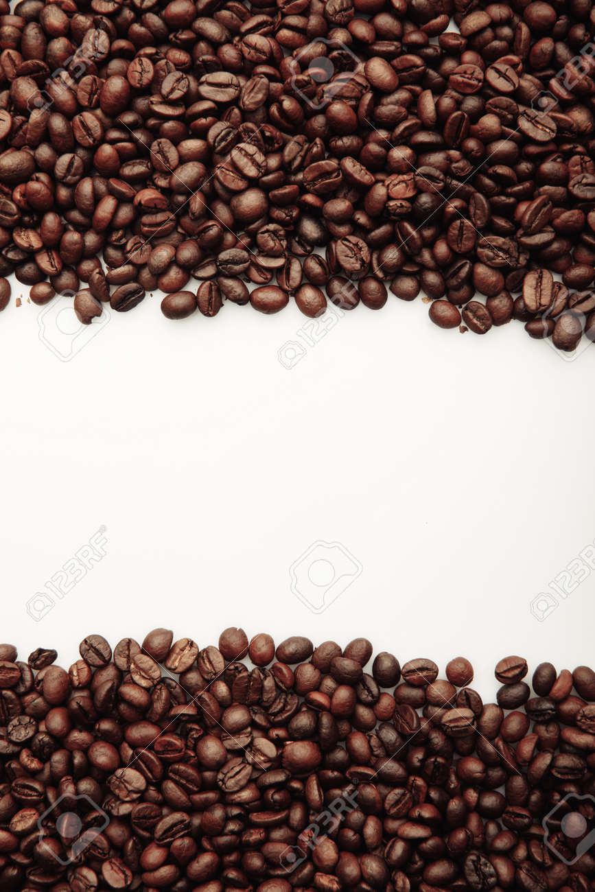 Coffee beans isolated on white. Vertical image - 169820288