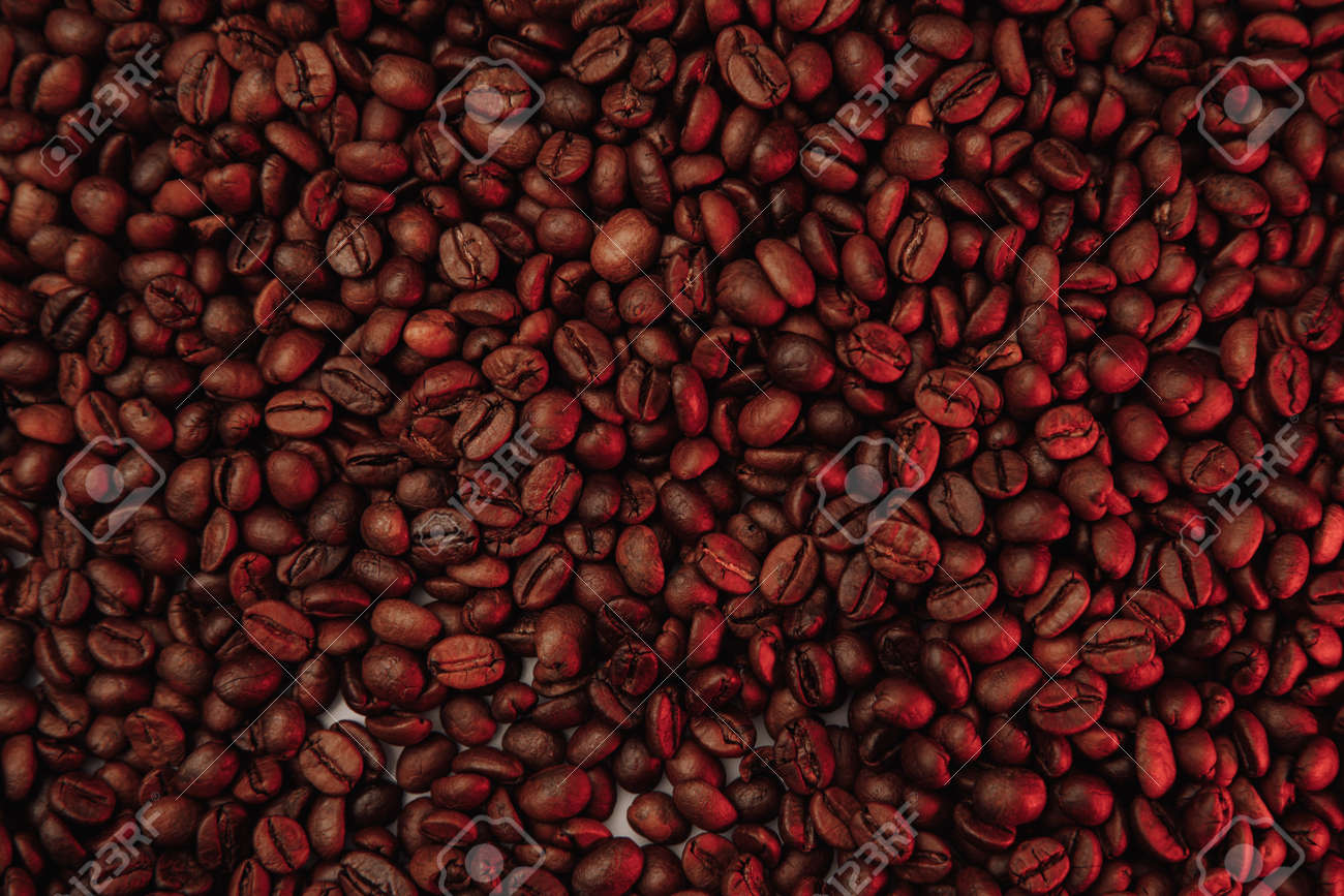 Roasted coffee beans background in red color - 169820847