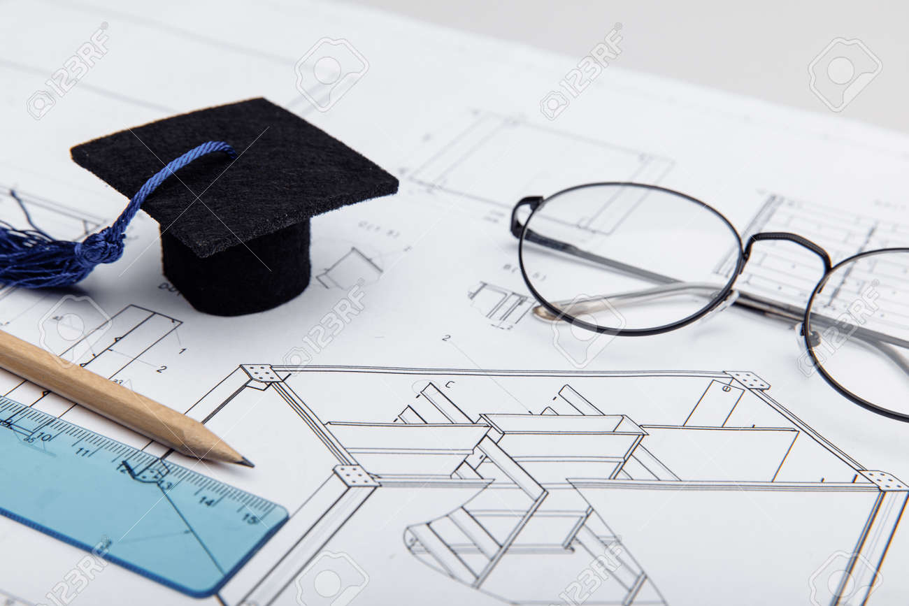 Technical drawings and graduation cap close-up. Engineering education concept - 172813872