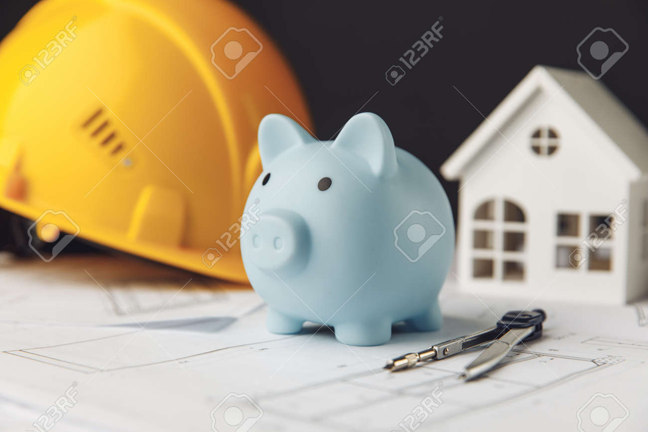 Construction safety helmet, house and blue piggy bank. Building and business concept - 172813347