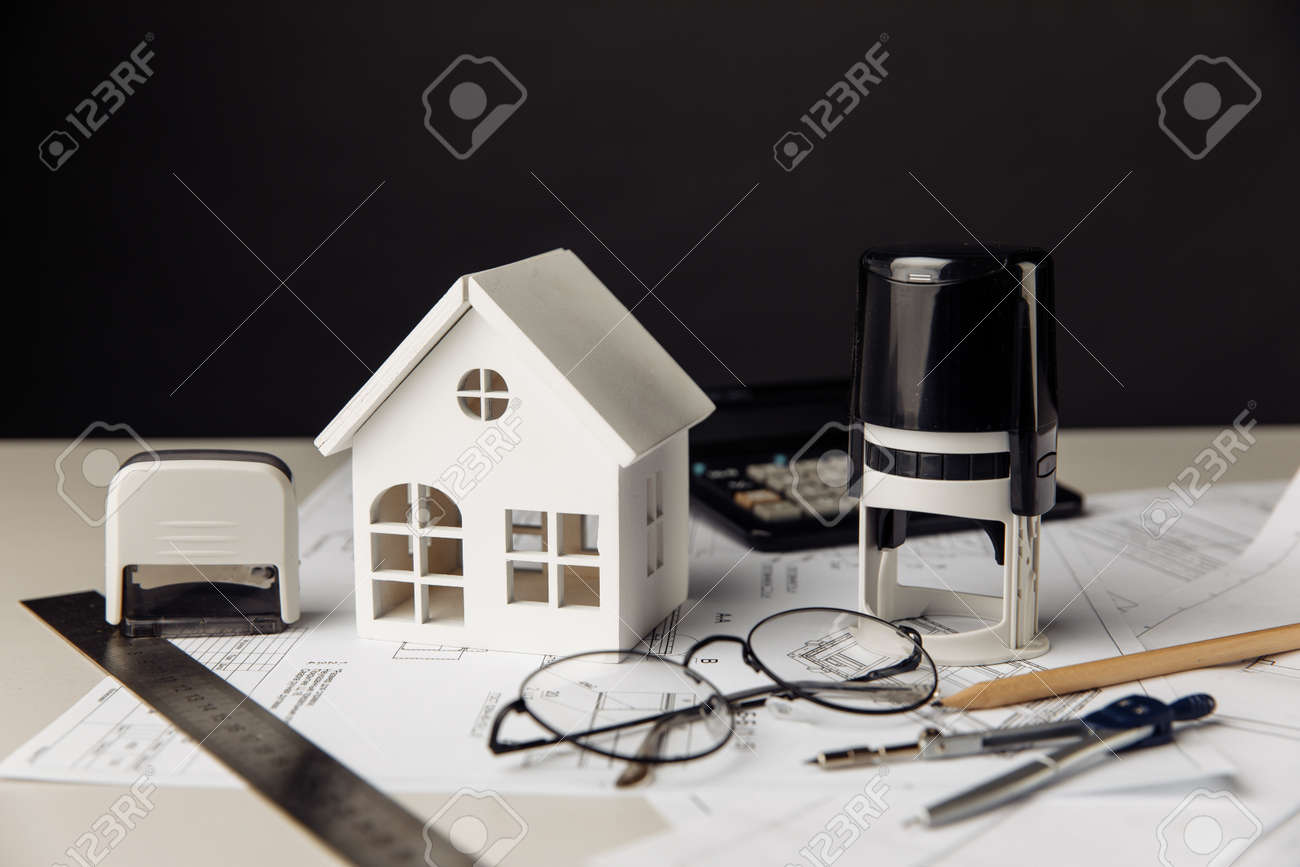 Drawing with model of house, calculator and stamps, building business and investment concept - 172813794