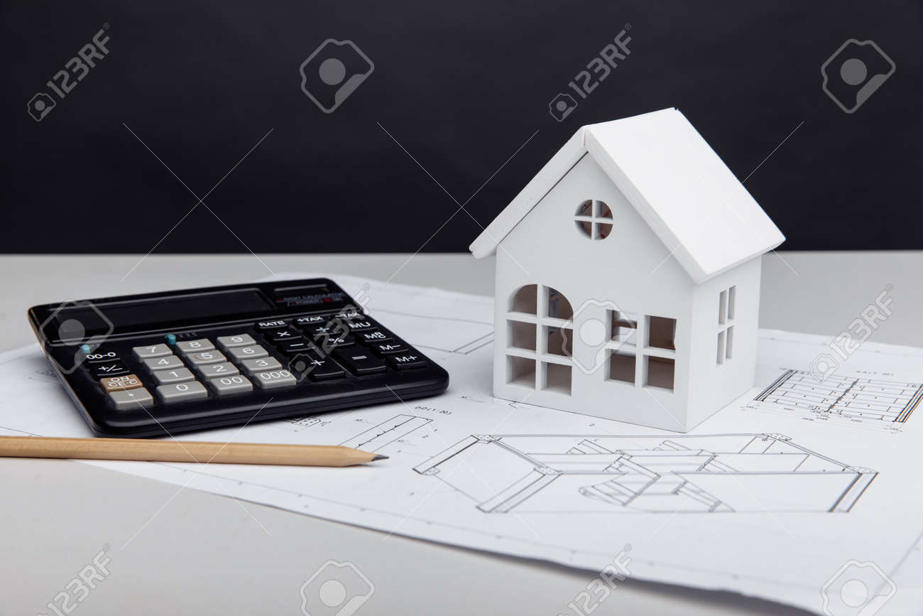 White house and calculator on drawing. House building estimate concept - 173213433