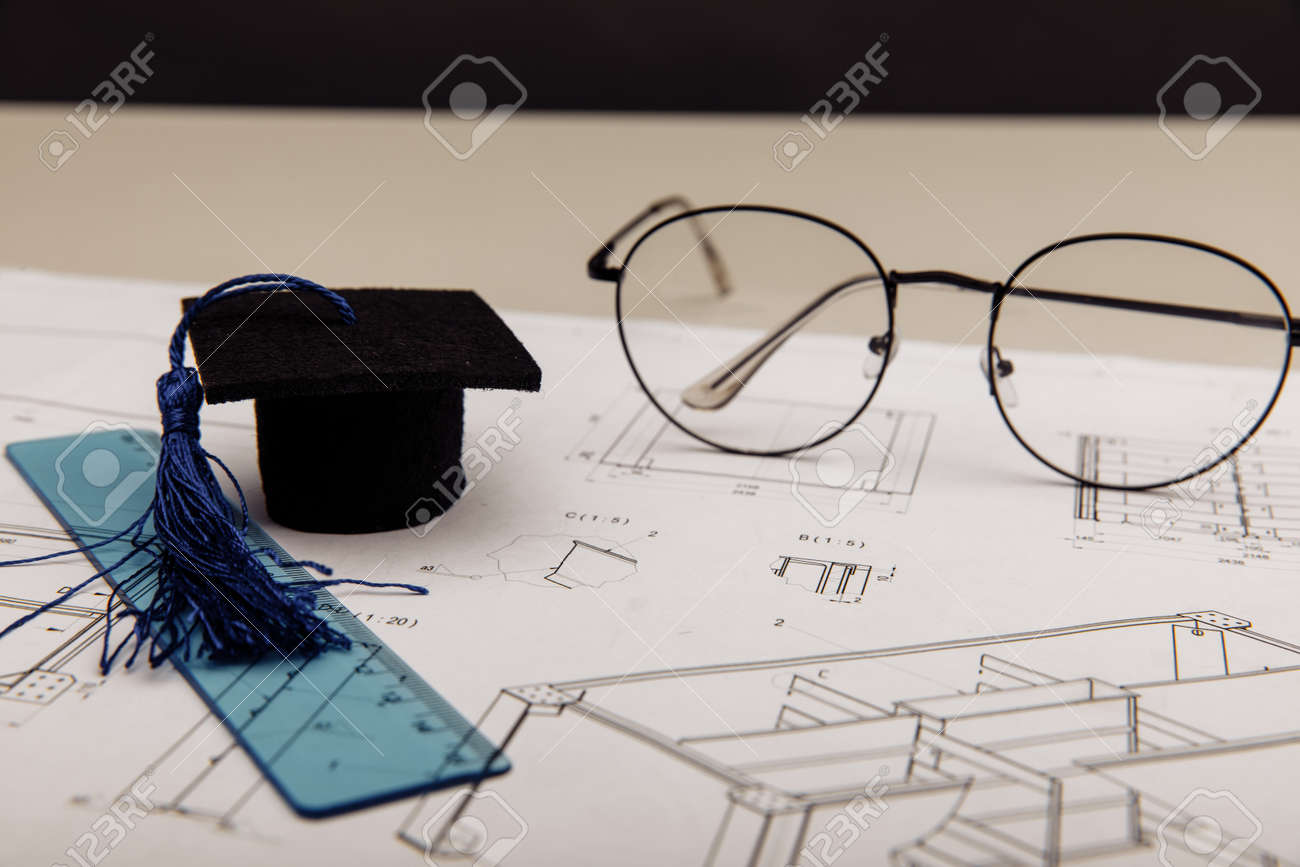 Technical drawings and graduation cap. Engineering education concept - 173213372