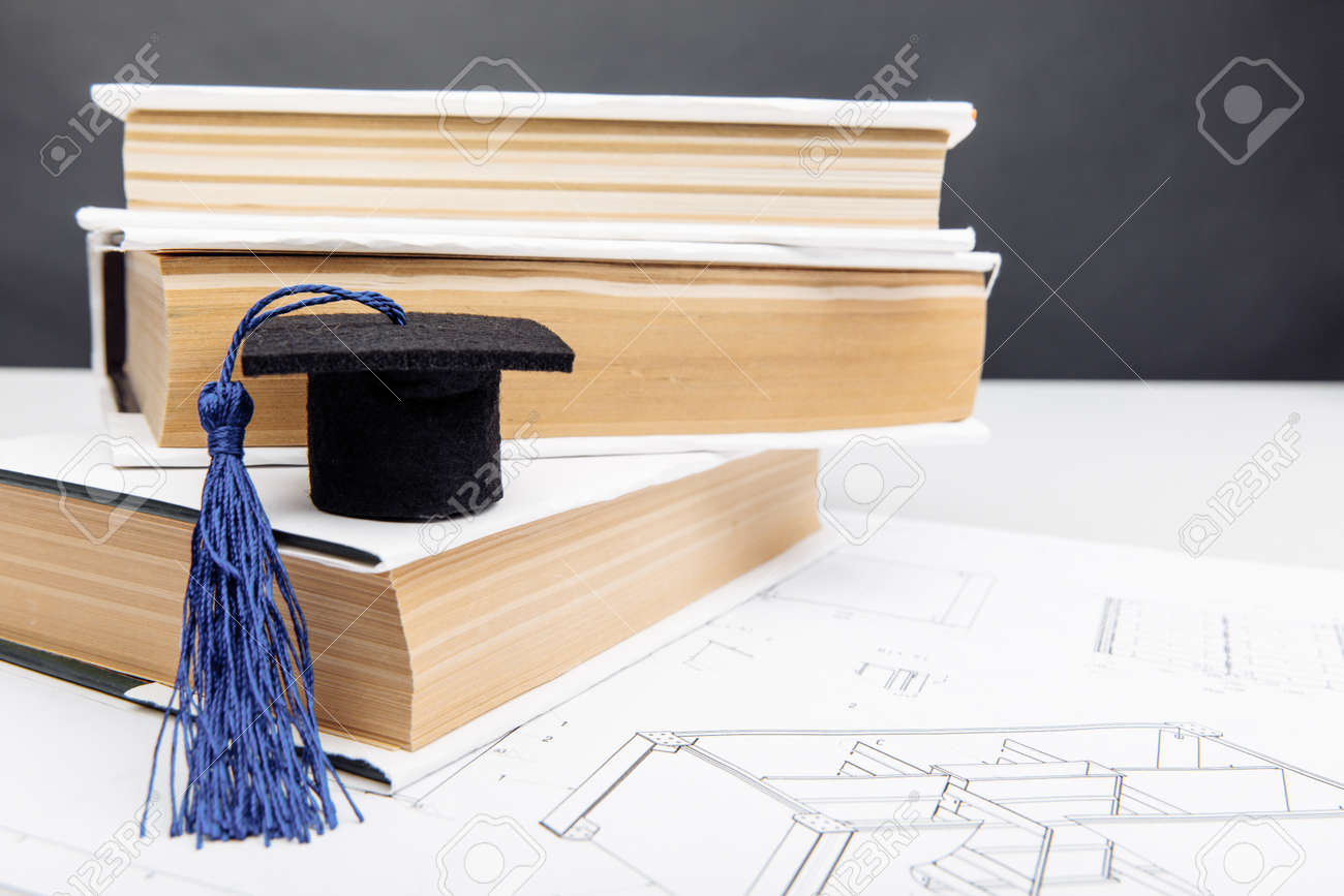 Technical drawings and graduation cap with books. Engineering education concept - 173213443