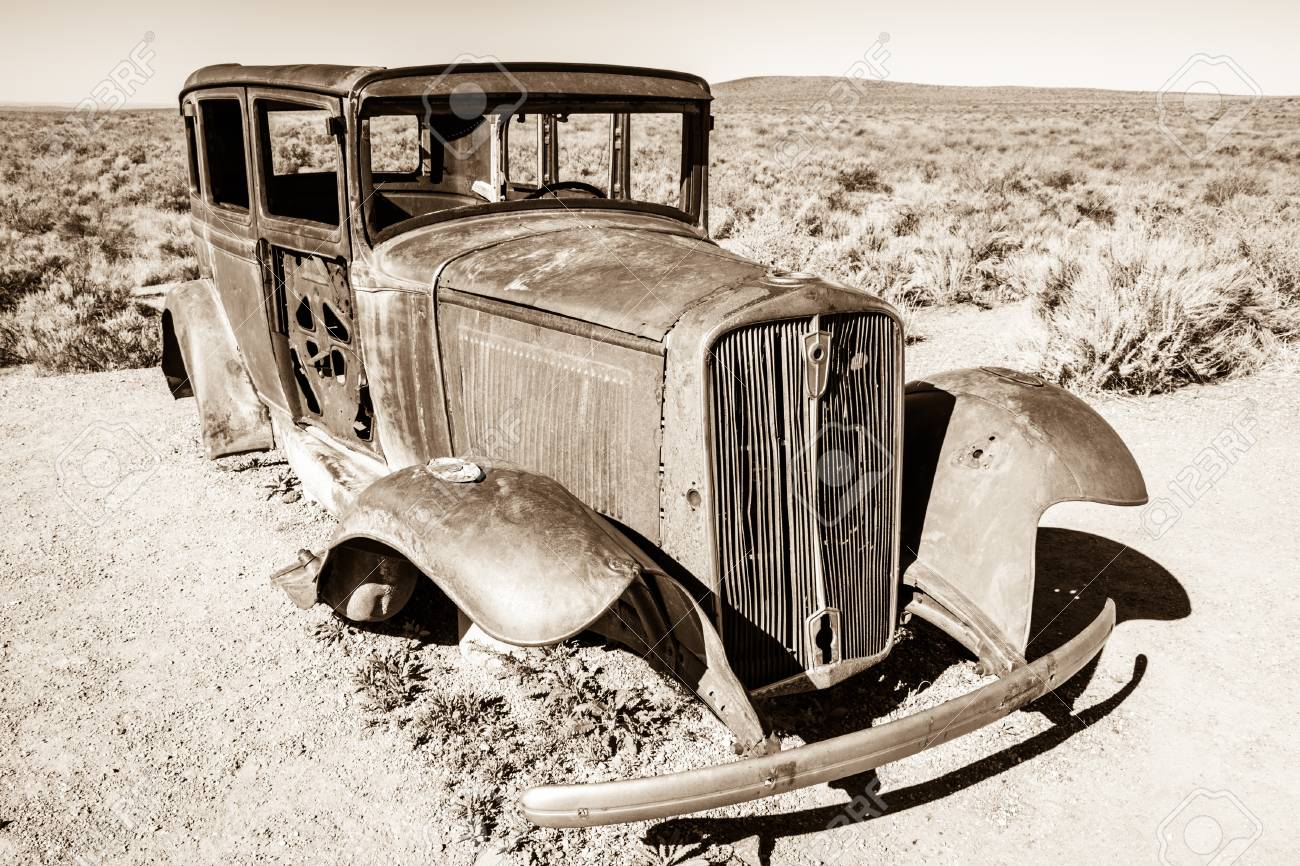A Sepia Toned Black And White Image Of A Rusted Antique Car With ...