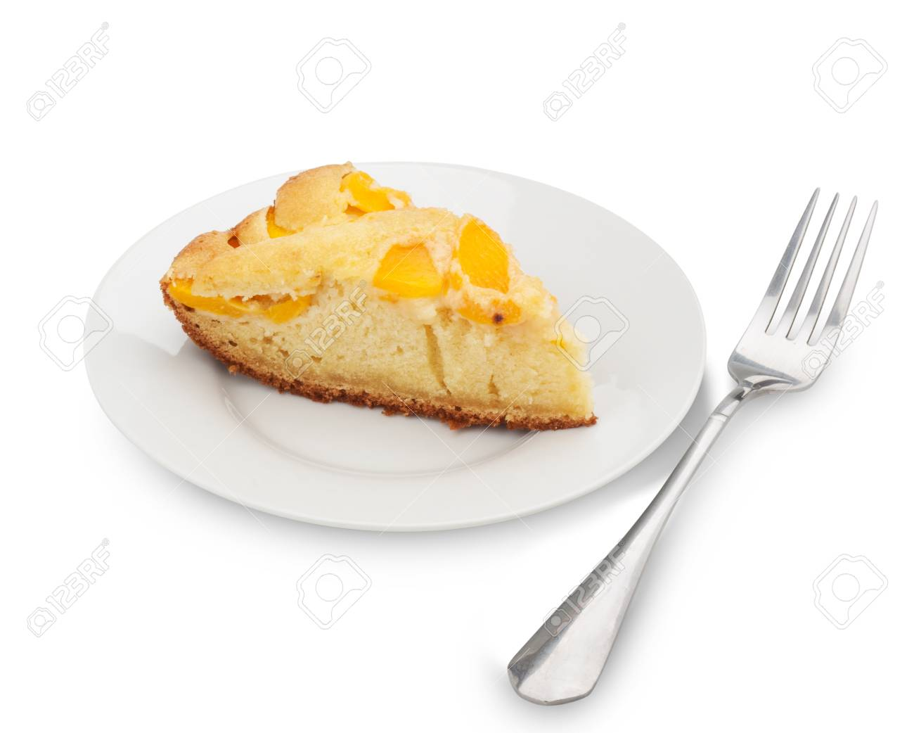 Piece of cake with peaches on a plate on a white background. Clipping Path Stock Photo - 18116487