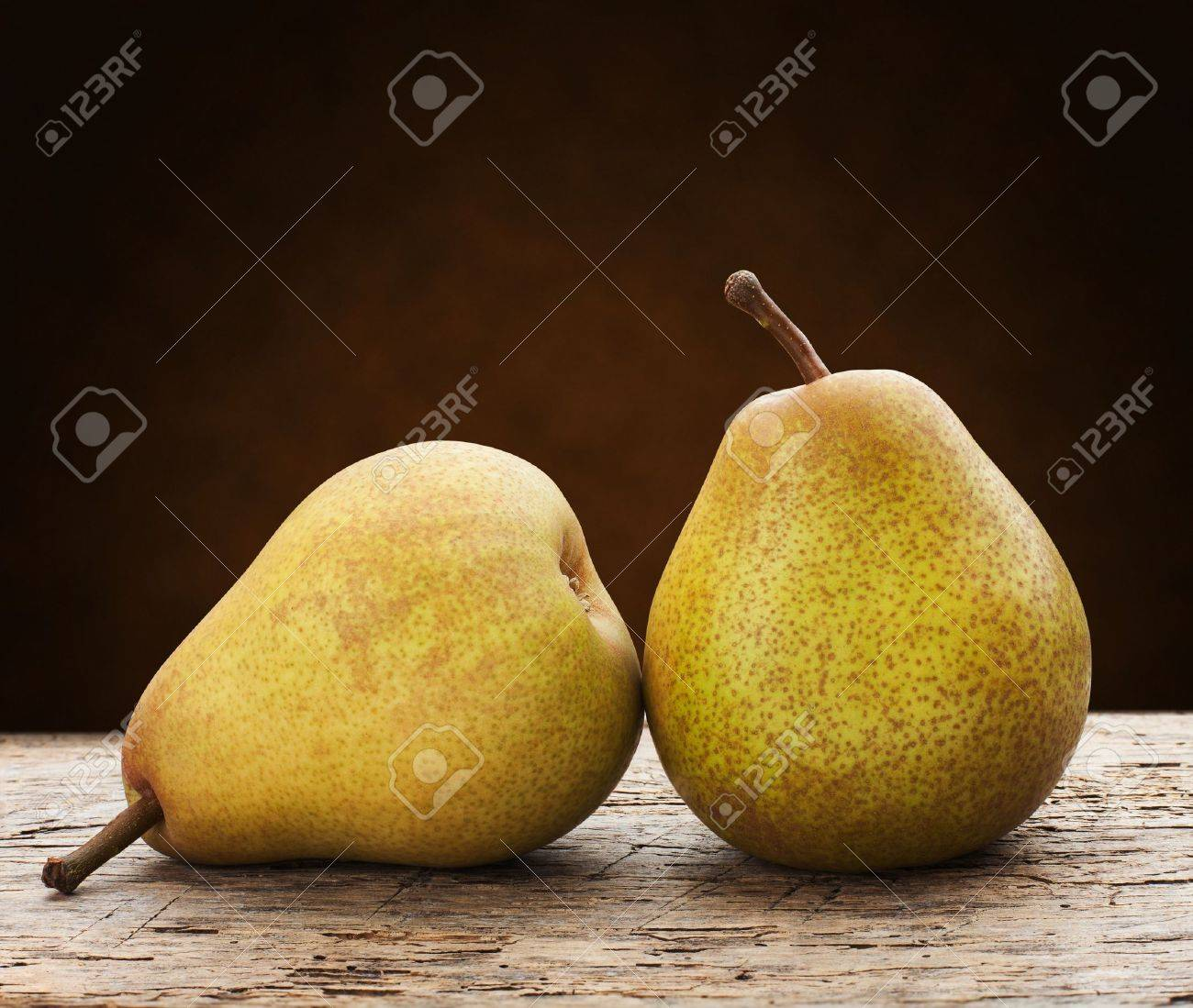 green pears on a wooden table - 18968896