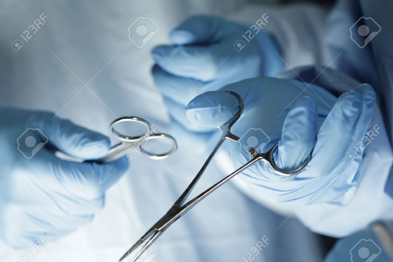 Surgeon s hands in surgery Stock Photo - 19141114