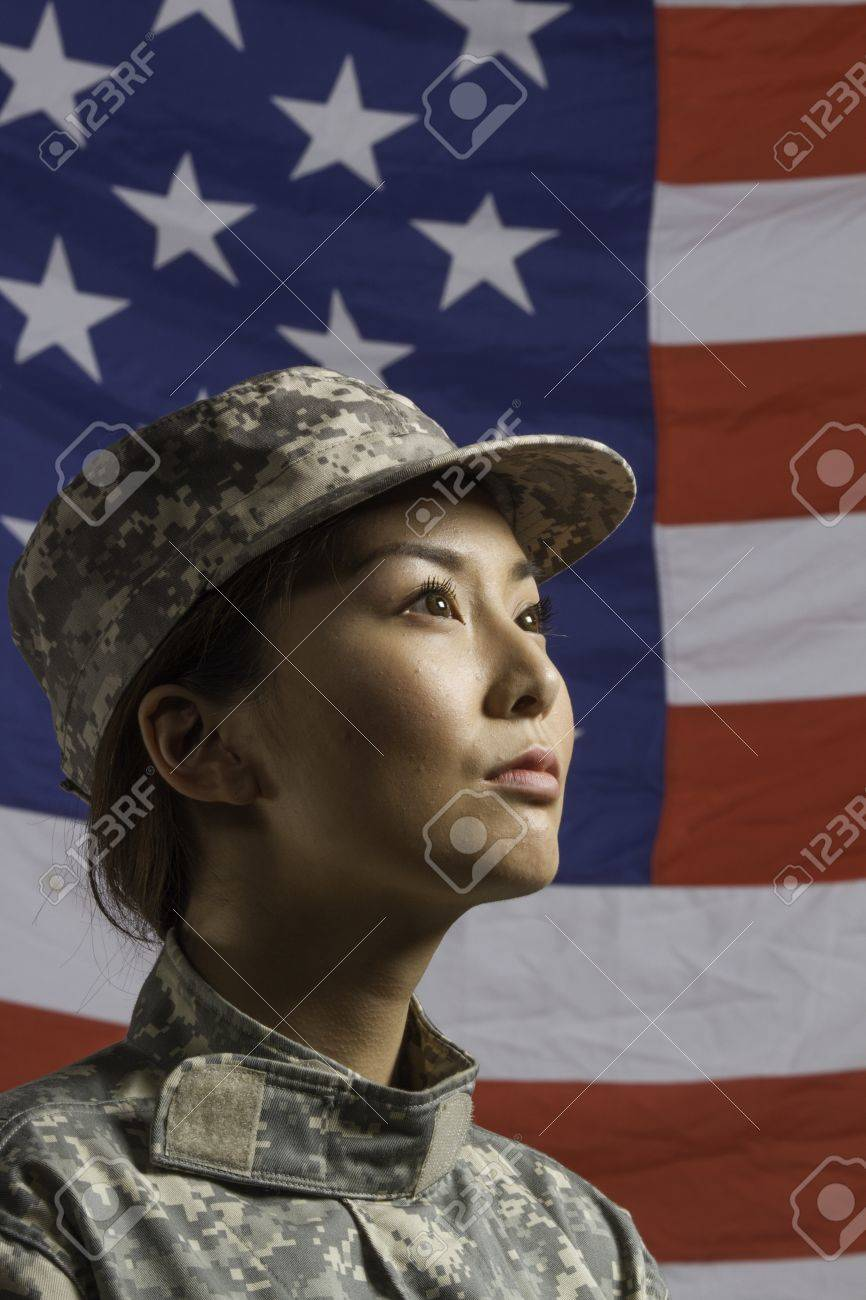 Asian american military woman pictured in front of us flag asian american military woman pictured in front of us flag vertical stock photo sciox Gallery