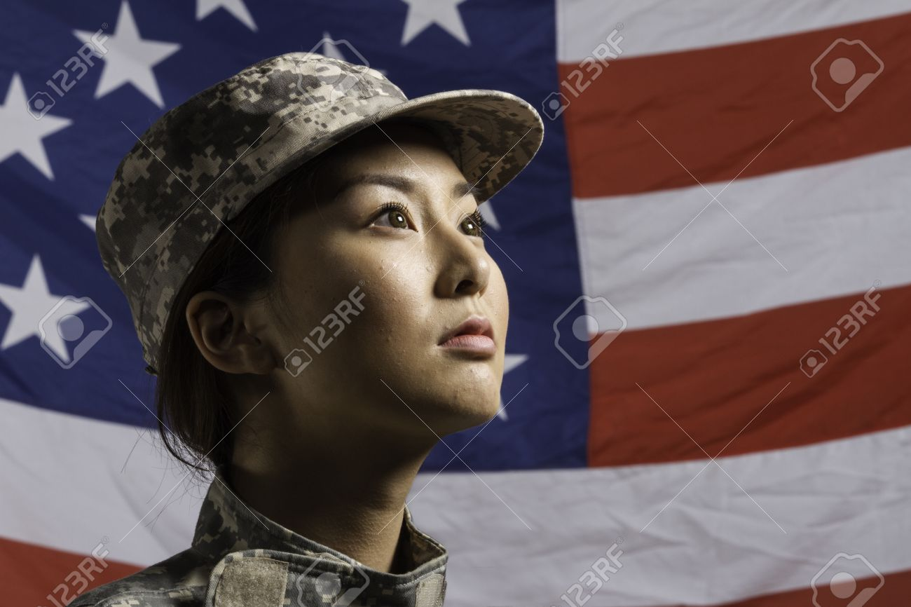Asian american military woman pictured in front of us flag asian american military woman pictured in front of us flag horizontal stock photo sciox Gallery