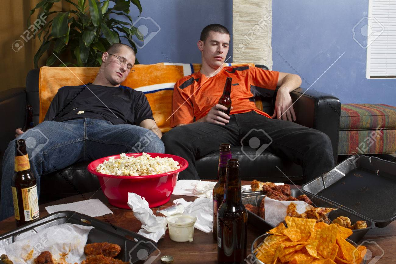 two tired men watching game on tv horizontal stock photo picture stock photo two tired men watching game on tv horizontal