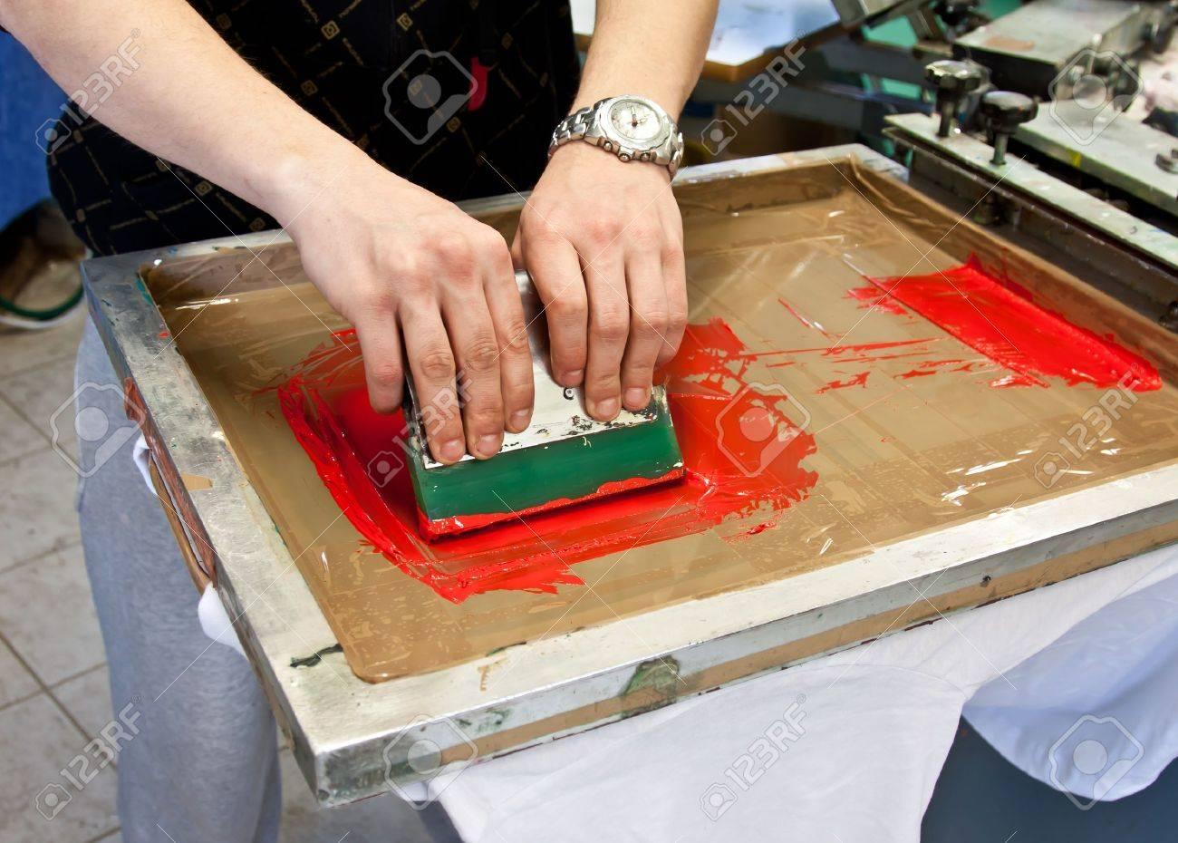 manual screen printing - hand printing t-shirts Stock Photo - 12818366