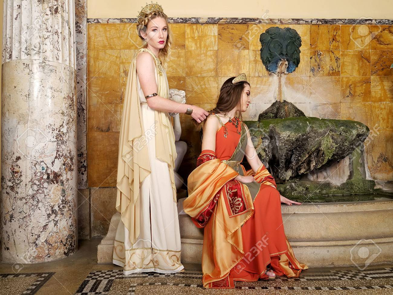 7220aad9323 Women In Traditional Roman Clothing Posing In Temple Stock Photo ...