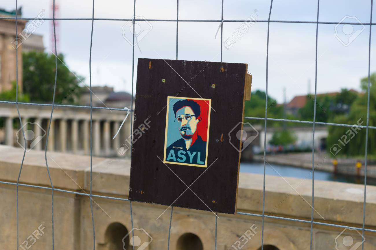 BERLIN, GERMANY - JUNE 06, 2014: Stylized portrait of Edward Snowden on the fence. Former officer of the CIA and NSA. - 30373581