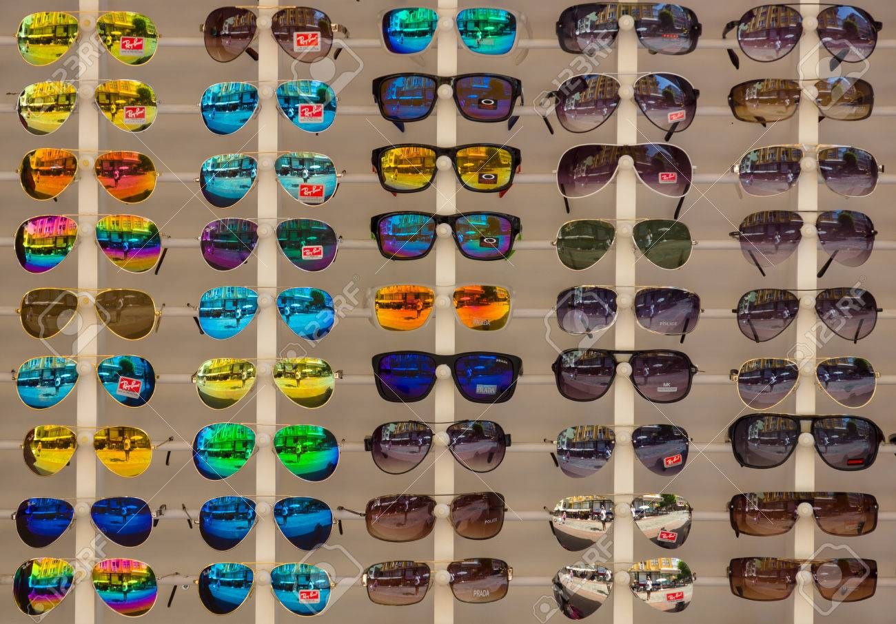 ALANYA, TURKEY - JUNE 28, 2014: Sunglasses Ray-Ban. Background. Ray-Ban is a internationally well-known brand of sunglasses and eyeglasses founded in 1937. - 31750052
