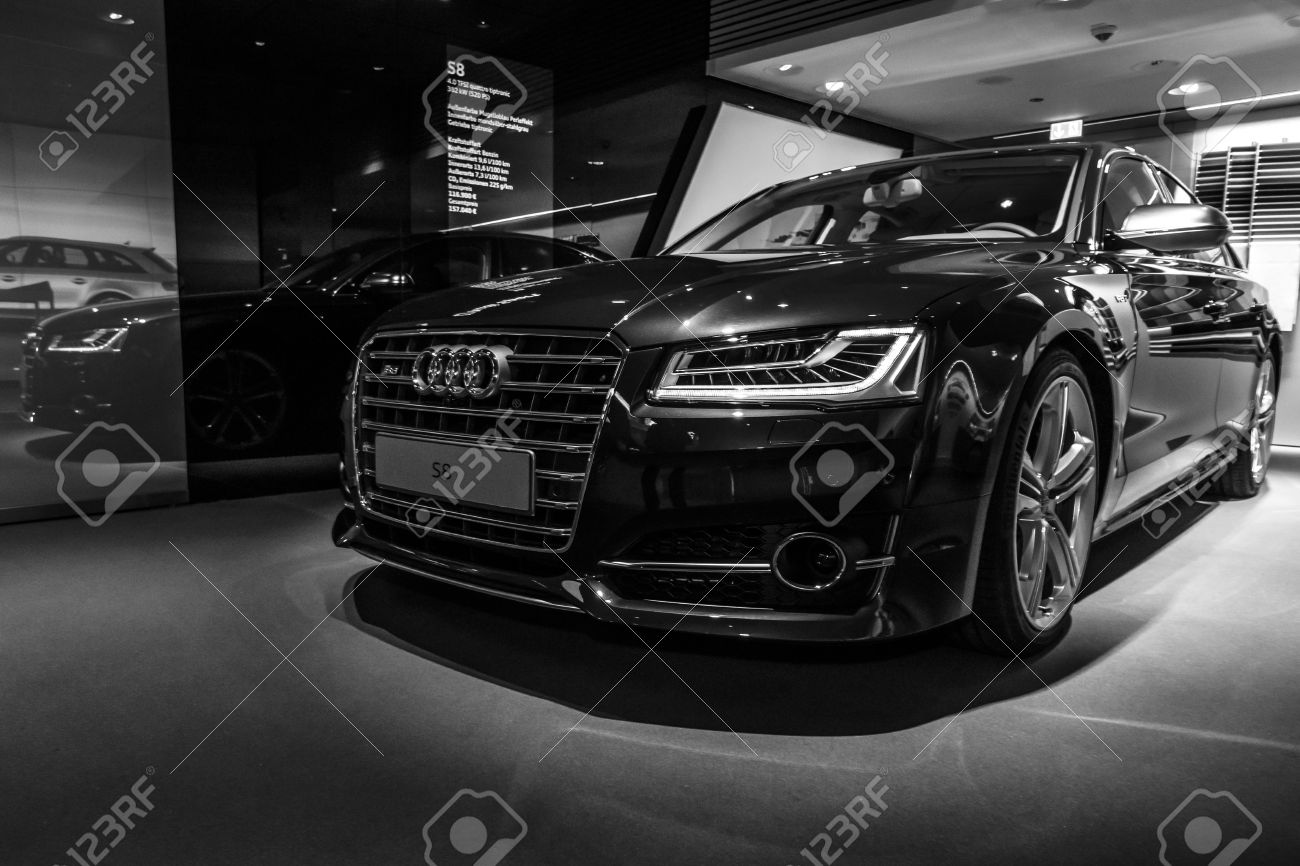 BERLIN - MARCH 08, 2015: Showroom. Full-size luxury car Audi S8. Black and white. Audi AG is a German automobile manufacturer. - 37796230