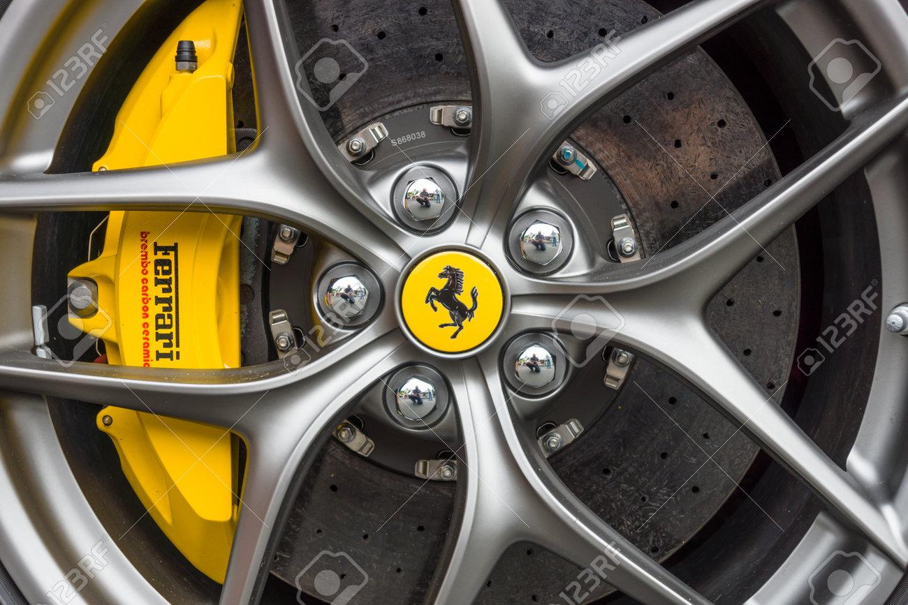 BERLIN - JUNE 14, 2015: Wheel and brake system of sports car Ferrari F12berlinetta. The Classic Days on Kurfuerstendamm. - 42902358