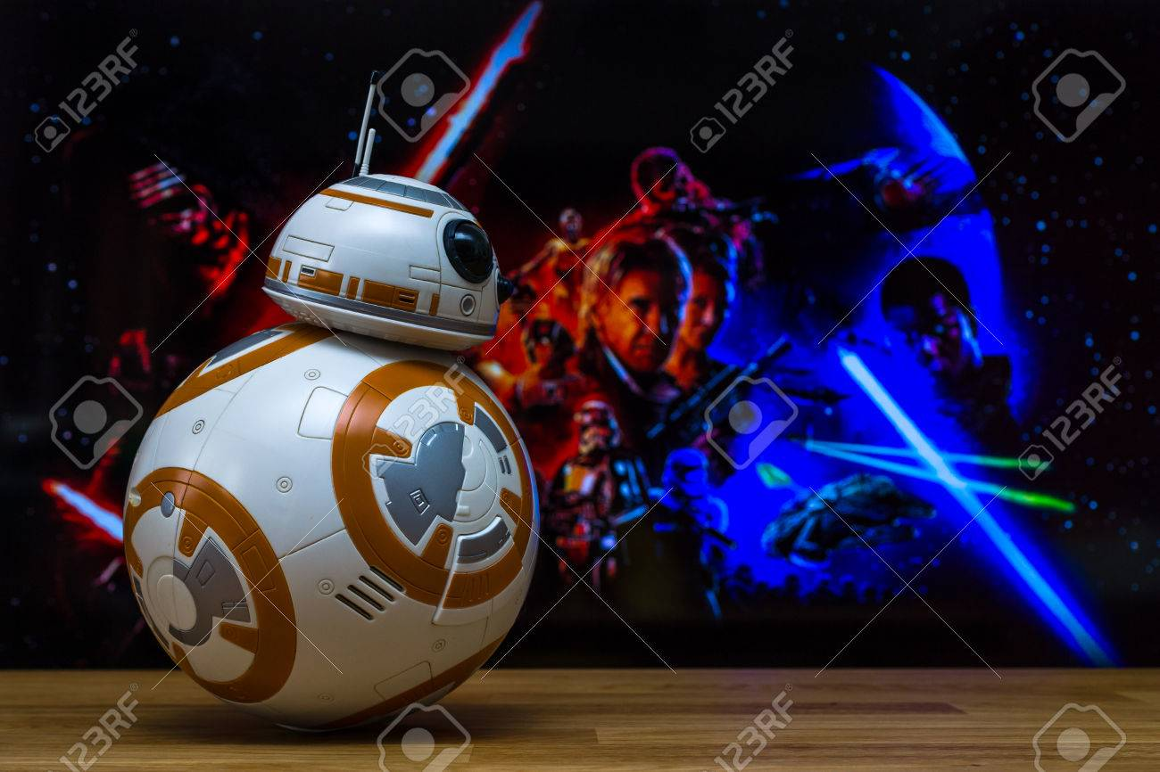 BERLIN, GERMANY - JUNE 10, 2016: BB-8 Android Models on the background of the official poster of the new movie of the saga Star Wars: The Force Awakens. - 58095654