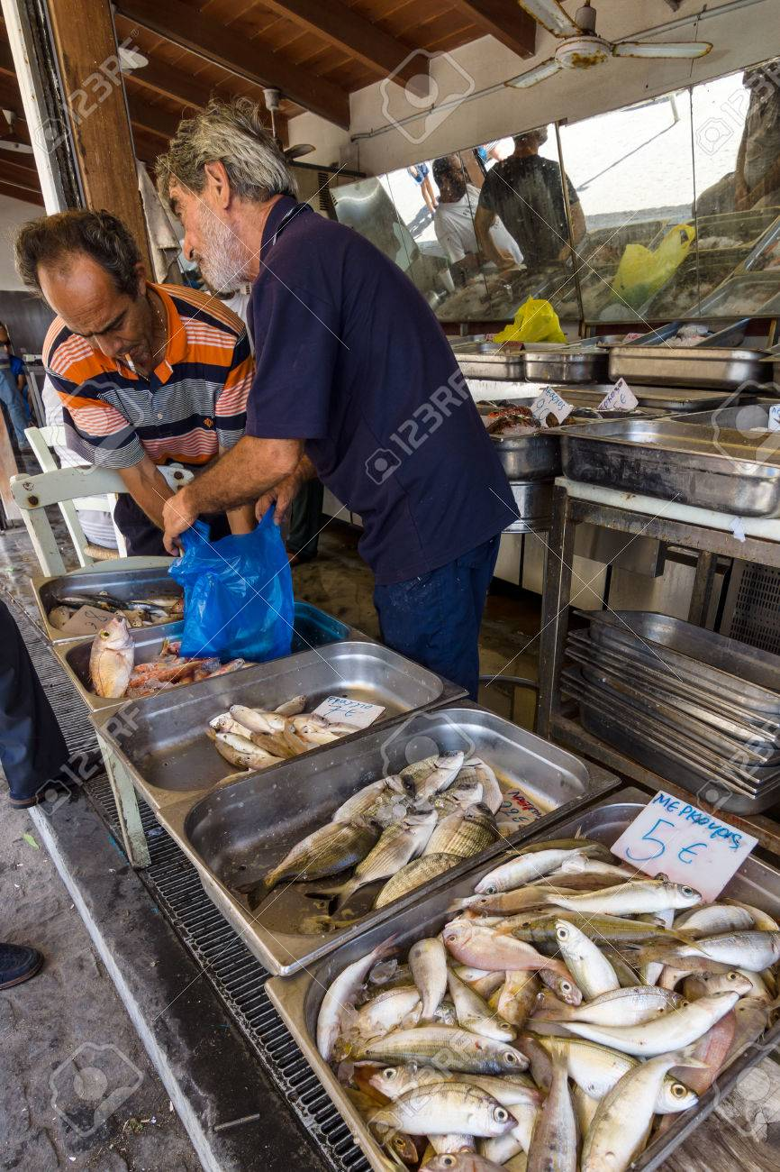 HERAKLION, GREECE - JULY 16, 2016: Crete  The buyer and the seller