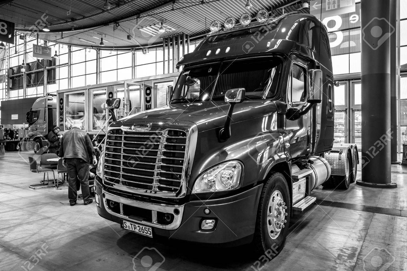"""STUTTGART, GERMANY - MARCH 03, 2017: Truck Freightliner Cascadia Evolution, 2015. Black and white. Europe's greatest classic car exhibition """"RETRO CLASSICS"""" - 77557100"""