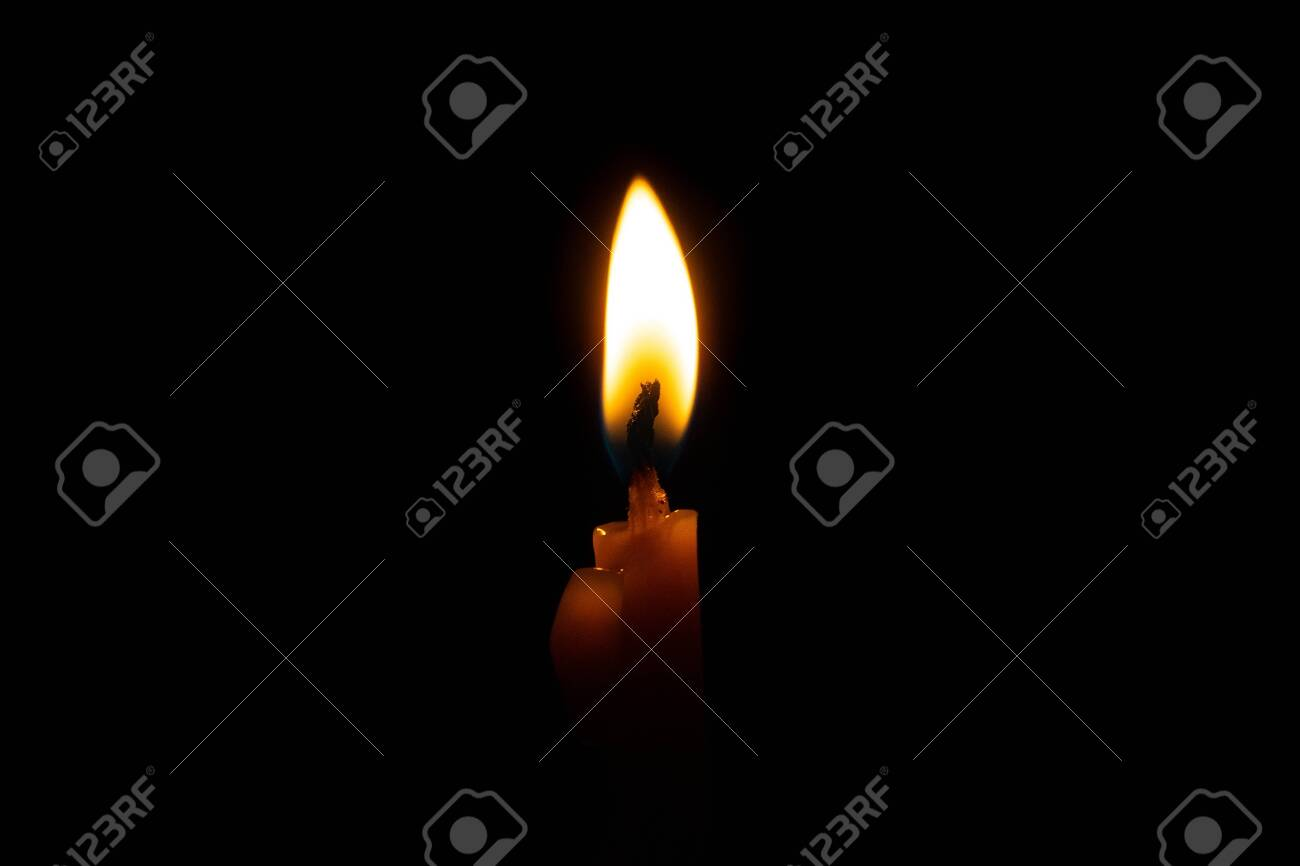 Candle flame close up on a black background - 125195705