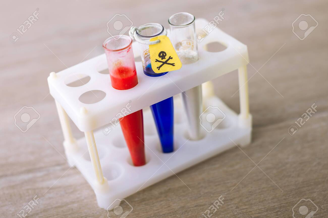 Russian-made poisons - 3 test tubes with Russian flag colors, yellow tag, toxic hazard sign - 144657892