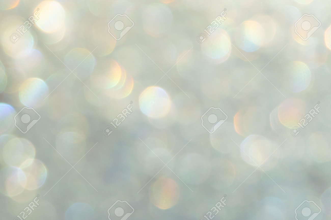 bright glitter background: bokeh effect from many colored lights on frozen glass, toning - 166073687