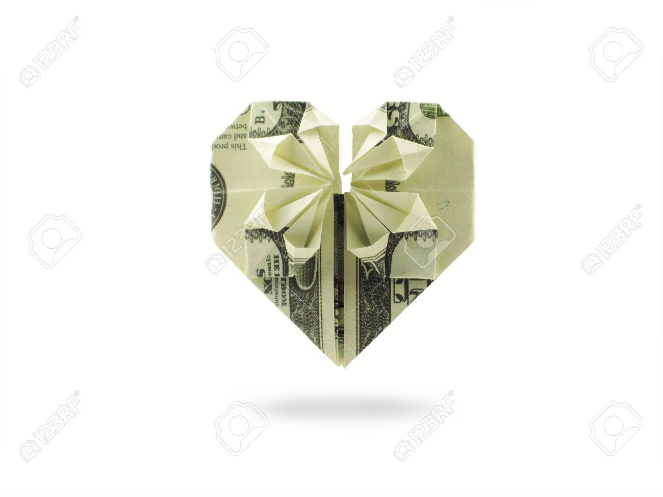 Origami heart of hundred dollar banknote stock photo picture and origami heart of hundred dollar banknote stock photo 31741783 jeuxipadfo Images