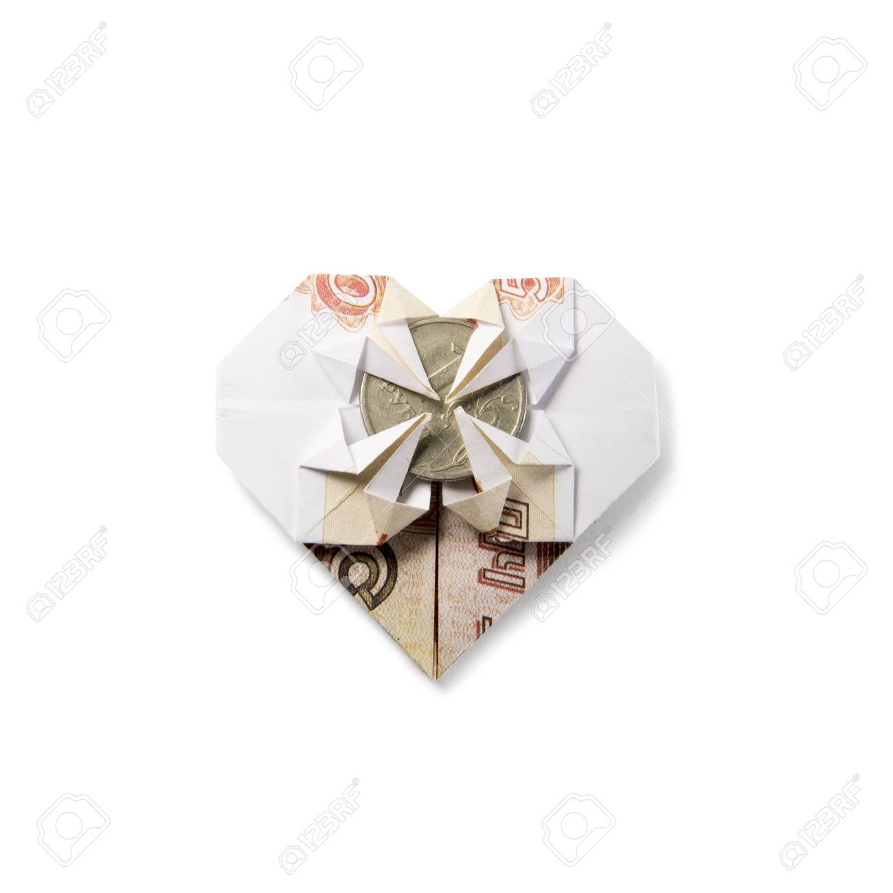 Origami heart of banknotes on a white background stock photo origami heart of banknotes on a white background stock photo 67963270 jeuxipadfo Images