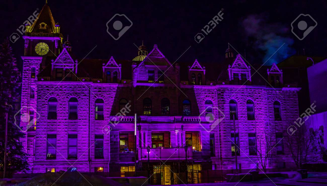 historic city hall bathed in purple christmas lights calgary alberta canada stock photo