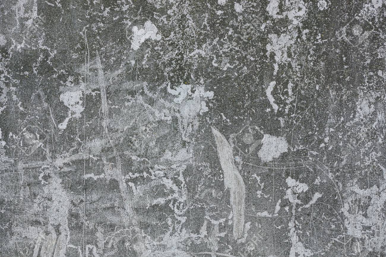 Gray stone texture from a worn concrete wall - 105744926