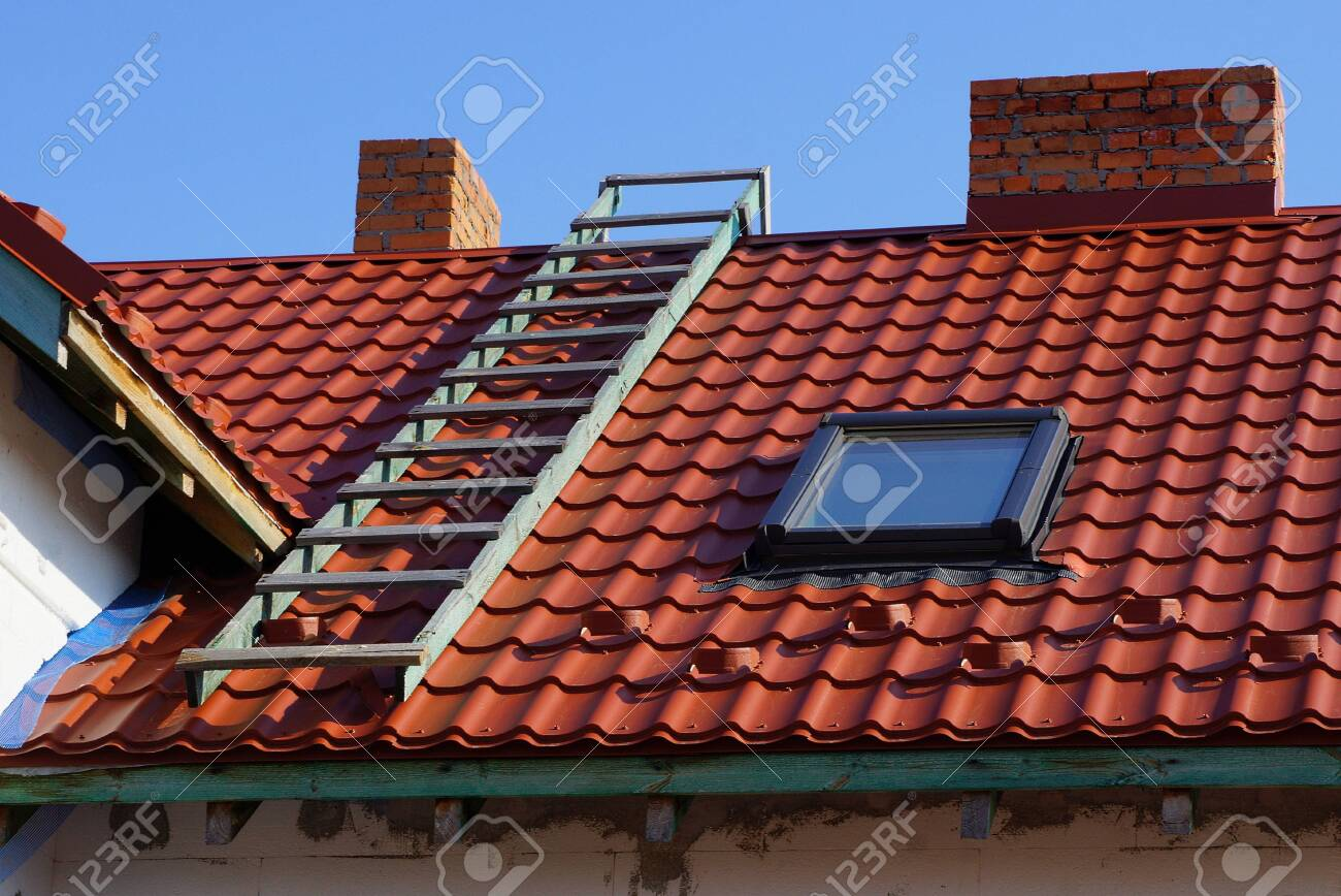 red tile roof with window stairs and chimney - 120098274